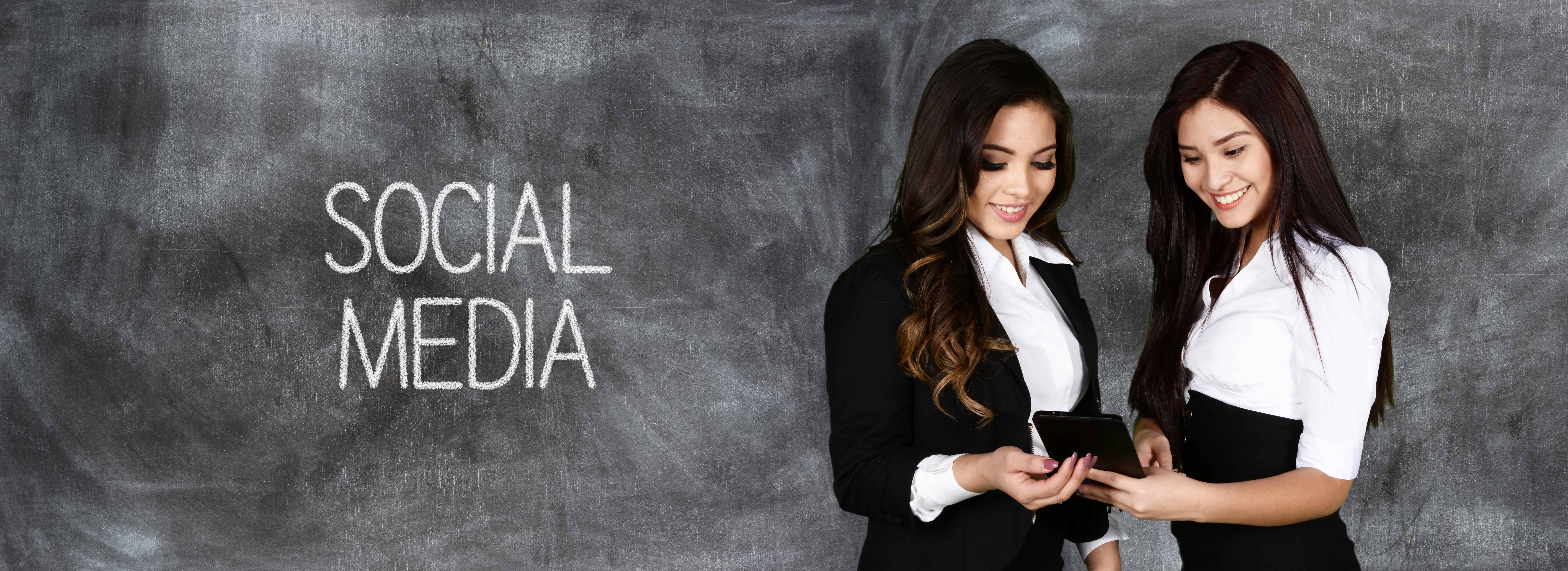 Confident businesswomen who are working on social media